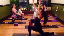 Yoga School Director Lennessa Shantaya teaches the class a pose.