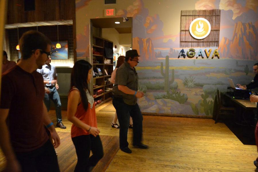Instructor teaches participants how to salsa dance at Agava Restaurant